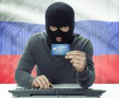 Russischer Hacker vor Flagge